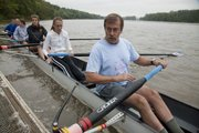Stuart Beals, right, Lawrence, steadies his oar as crew members push off on the Kansas River. A rowing clinic was opened to the public Saturday at the KU Boathouse in Burcham Park. The event was hosted by the Kansas rowing team and the Lawrence Parks and Recreation Department.