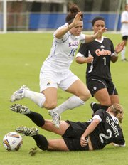 Kansas' Caroline Kastor (10) leaps Florida player Annie Bobbitt's tackle Sunday, Sept. 18, 2011 at KU.