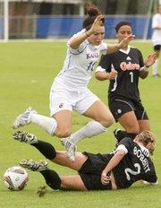 Kansas' Caroline Kastor (10) leaps Florida player Annie Bobbitt's tackle Sunday, Sept. 18, 2011 at KU.