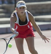 Lawrence High No. 1 singles player Xoe Schneider returns a volley against a Shawnee Mission West opponent during a Lawrence High School quad tennis meet Monday, Sept. 19, 2011 at LHS.