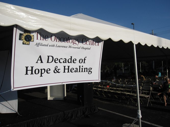 A sign bears the theme of the 10th anniversary celebration of Lawrence Memorial Hospital's Oncology Center. The center serves about 600 new patients each year and administers about 18,000 treatments.