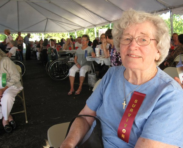 Doris Sullivant, Lawrence, awaits a brief program during a community celebration Tuesday, Sept. 20, 2011, that marked the 10th anniversary of Lawrence Memorial Hospital's Oncology Center. She was among the first cancer patients treated at LMH in 2000.