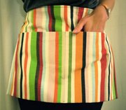 A utility apron with deep pockets works for gardening, home projects, garage sales and more.
