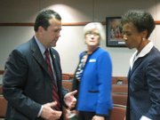 KU AD Sheahon Zenger speaks with KU Chancellor Bernadette Gray-Little on Wednesday, Sept. 21, 2011 before heading into an executive session with the Kansas Board of Regents.