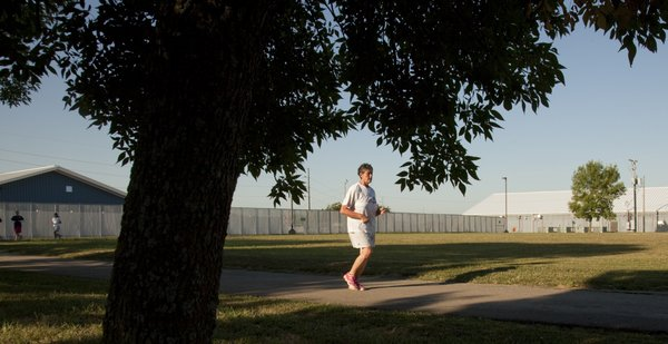 Laura Kreisler, who is serving for time for embezzlement, takes a morning run Friday, Sept. 23, 2011, at the Topeka Correctional Facility. Kreisler, who was diagnosed with Parkinson's disease in 2001, says running has been a benefit physically and emotionally.