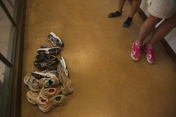Shoes that were donated to Running Free, an inmate running group at the Topeka Correctional Facility.