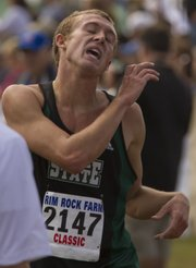 Free State's Kain Anderson relaxes just after crossing the finish line of the boys 5k run in the Rim Rock Classic on Saturday, Sept. 24, 2011 at Rim Rock farm north of Lawrence. Anderson finished eighth overall with a time of 15:59.7.