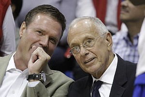 Current Kansas University basketball coach Bill Self, left, and former KU coach Larry Brown visit on the bench during the Legends of the Phog game Saturday, Sept. 24, 2011 at Allen Fieldhouse.