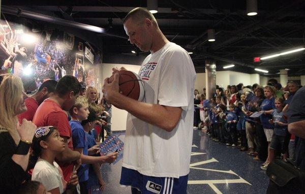 Greg Ostertag signs autographs before the tip-off of the Legends of the Phog game Saturday, Sept. 24, 2011 at Allen Fieldhouse.