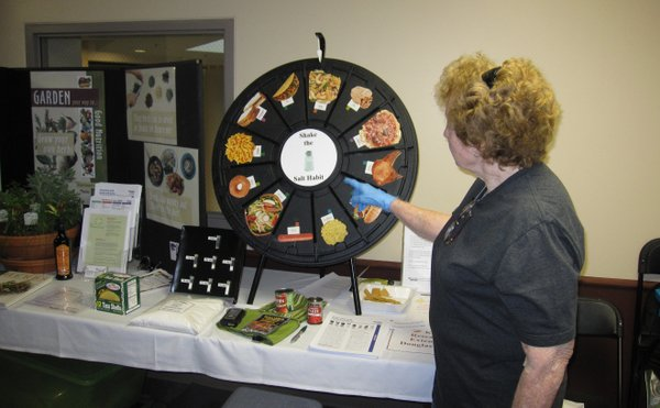 Margaret Fuston, a volunteer with K-State Research and Extension — Douglas County, points out that peanut butter and jelly sandwich contains a half teaspoon of salt during the health and wellness fair Saturday, 24, 2011, at Lawrence Memorial Hospital, 325 Maine.