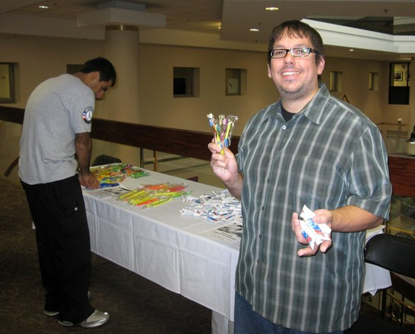 Raymond Munoz, of Douglas County Dental Clinic, was giving out toothbrushes and toothpaste during the health fair at LMH.