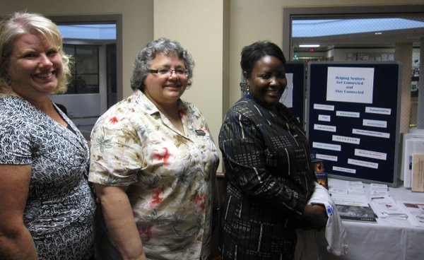 From left are Tina Roberts, Janet Ikenberry and Jessie Kwatamdia, of Douglas County Senior Services. They were at the LMH health fair Saturday.