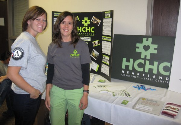 Caci Moore, an AmeriCorps volunteer, and Karin Denes-Collar, a clinical social worker, were answering questions about Heartland Community Health Center during the health fair Saturday, Sept. 24, 2011, at Lawrence Memorial Hospital. HCHC is a safety net clinic in Lawrence that is located on the east end of the Riverfront Mall.