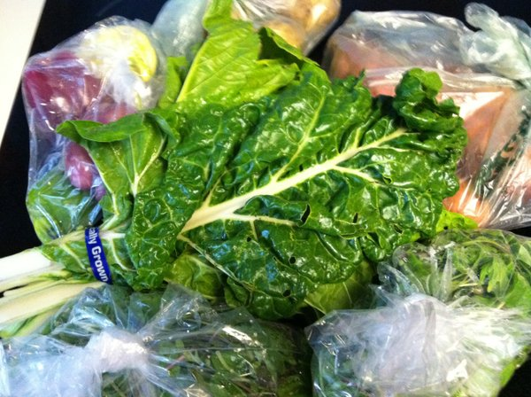 Our last CSA pick up of 2011: chard leaves, two bags of mixed salad greens, sweet potatoes, peppers and potatoes.