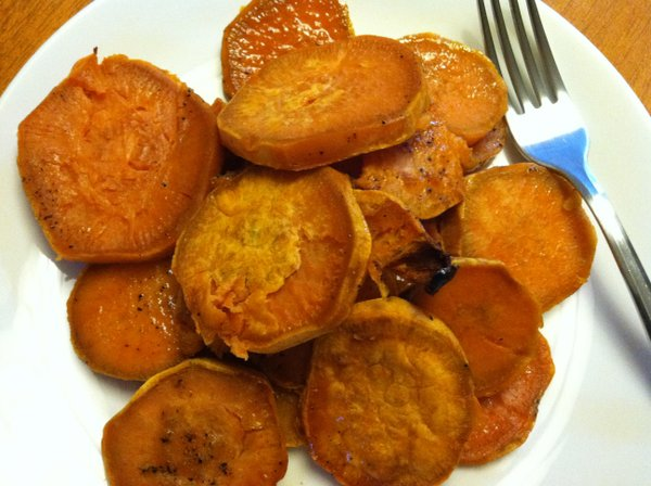 One of our fall/winter staples: sweet potatoes sliced into medallions and covered with a mixture of pepper, salt and a little brown sugar.
