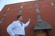 Developer Tony Krsnich, a Kansas University graduate, is getting ready to take on one of his biggest projects, a redevelopment of the old Poehler building at Eighth and Delaware streets in east Lawrence. Krsnich wants to turn the building into modern, rent-controlled apartments.
