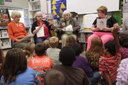 "The Lawrence Vintage Players from left, Terry Smith, Mary Ann Saunders, Pat Guy and Jane Robshaw, took time to read ""Rumpelstiltskin"" to some 2nd graders at Corley Elementary School."