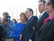Former U.S. Sen. Bob Dole and his wife Elizabeth, center, listen to speeches Sept. 30. 2011, during a ceremony unveiling Kansas Walk of Honor plaque in Dole's honor. At left is Gov. Sam Brownback and his wife Mary.