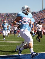 Kansas running back Brandon Bourbon celebrates his touchdown against Texas Tech during the first quarter on Saturday, Oct. 1, 2011 at Kivisto Field.