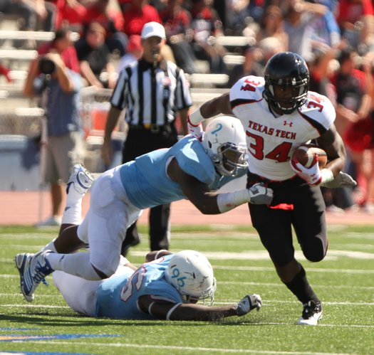 Texas Tech running back Kenny Williams eludes Kansas defenders Darius Willis (2) and Keba Agostinho (96) during the fourth quarter on Saturday, Oct. 1, 2011 at Kivisto Field.