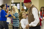 Christie Ghrist, Olathe, and Ed Reider, Prairie Village, partake in a Scandinavian Mixer Dance during the Nordic Heritage Festival on Saturday. Ghrist and Reider, who are members of the dance group Kansas City Scandinavian Dancers, were teaching festivalgoers traditional folk dances.