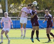 Kansas' Whitney Berry, left, and Texas A&M midfielder Megan Majewski (26) battle for control of the ball during Kansas' soccer match against Texas A&M Sunday, Oct 2, 2011 at KU. The Jayhawks fell 3-0.