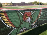 A Firebird adorns the new wind screen on the fence along the west side of the stadium at Free State High School.