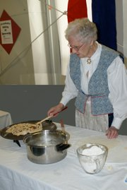 Nordic delight: Alietha Beckman, Lawrence, demonstrates the art of lefse making at the 2010 Nordic Heritage Festival. The 10th annual Nordic Heritage Festival was held Oct. 1 at the Douglas County Fairgrounds. Alietha's daughter, Marilyn Myers, submitted the photo.