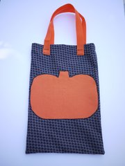 Kids can collect Halloween candy in a cute tote bag.
