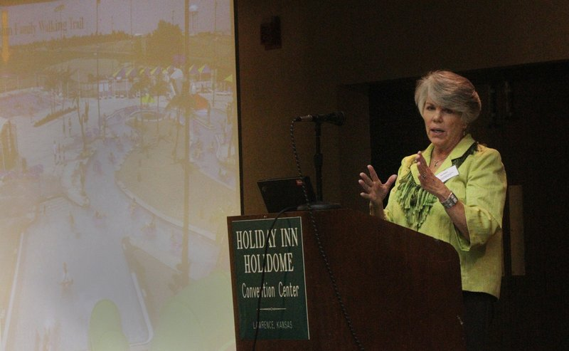 Sue Evans, of Colby, talks about her community's effort to open its first walking trail. She spoke during the Built Environment and the Outdoors Summit on Wednesday, Oct. 5, 2011, in Lawrence.