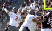 Oklahoma State quarterback Brandon Weeden (3) throws a pass against Texas A&M, Saturday, Sept. 24, 2011, in College Station, Texas. Weeden threw for a school-record 438 yards and two scores in their 30-29.
