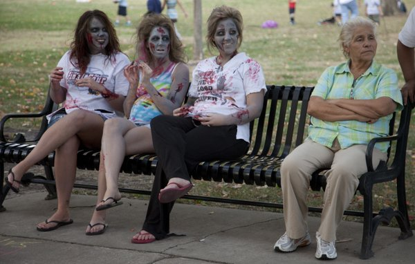 A trio of zombies wait for the start of the zombie walk in South Park before the fifth annual Lawrence Zombie Walk Thursday, Oct. 6, 2011. Over 500 people attended the walk with money raised from the event going to the Lawrence Humane Society.