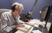 Audio Reader volunteer Thelma Taylor reads from “With a Crack in her Voice,” a memoir by actress Judi Dench. Taylor was recording the reading at Audio Reader for a later broadcast. Audio Reader is celebrating its 40th anniversary.