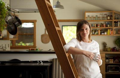Jessica Kellner, editor of Natural Home and Garden magazine, is pictured on Thursday, Sept. 6, 2011 in the dining area of her Lawrence home. Kellner, who has craftily furnished her own home with many reclaimed items, recently wrote a book about homes made of items that were otherwise destined for the dump.The book is called Housing Reclaimed.