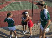 Free State tennis player Alita Joseph, left, and Lawrence High player Abby Gillam, right, hug and wish each other luck before the 6A regional tennis tournament at LHS on Friday, Oct. 7, 2011.