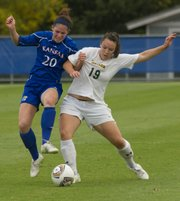 Baylor forward Christine Clark (19) fends off Kansas defender Shannon Renner (20) as the two battle for control of the ball Friday, Oct. 7, 2011 at KU.