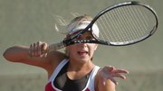 Lawrence High's Zoe Schneider competes in the 6A regional tennis tournament at LHS on Friday, Oct. 8, 2011.