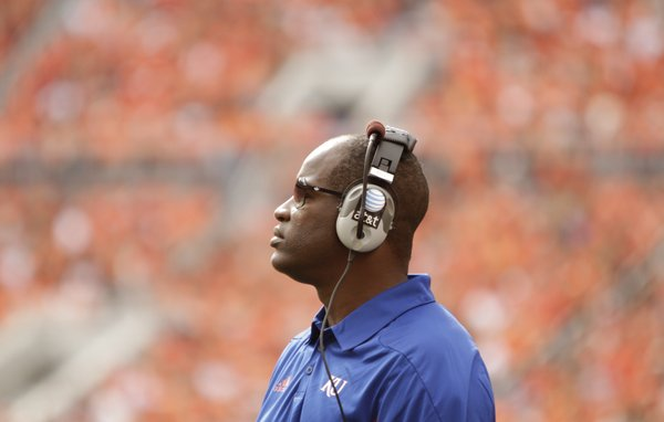 Kansas head coach Turner Gill watches from the sidelines during the second quarter against Oklahoma State on Saturday, Oct. 8, 2011 at Boone Pickens Stadium.