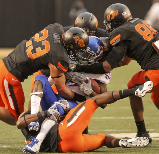Kansas receiver JaCorey Shepherd is smothered by the Oklahoma State defense after a catch during the fourth quarter on Saturday, Oct. 8, 2011 at Boone Pickens Stadium.