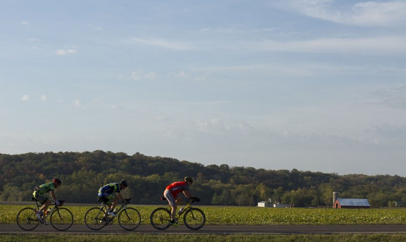 A group of cyclists ride west along North 950 Road as part of the annual Octoginta bicycle ride Sunday, Oct 9, 2011.
