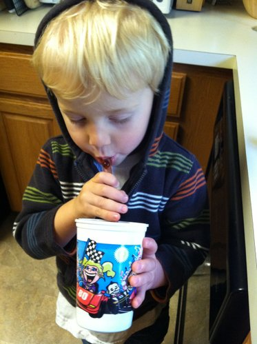 The kiddo tears into his smoothie. He doesn't seem to care what flavor it is, as long as he gets to pick out his straw (we use reusable glass straws from Glass Dharma).