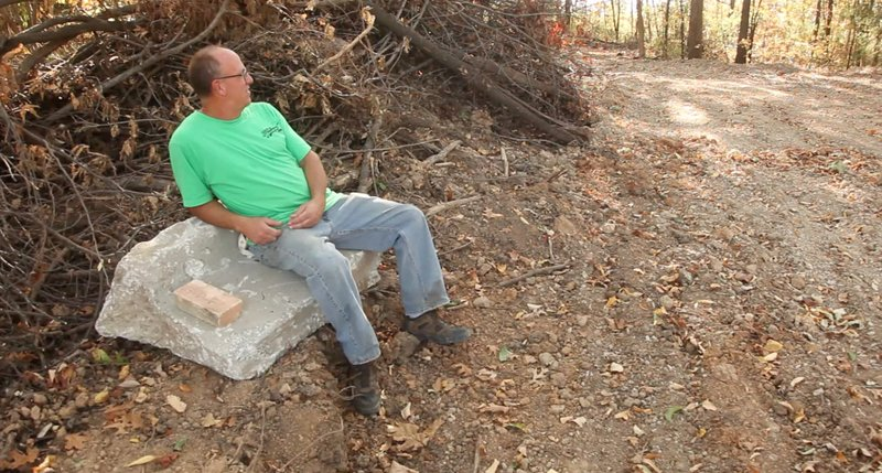 Dean Zagortz sits on a piece of curb on a old quarry site that he has reclaimed with business partner Holli Joyce. Named the GreenWill Land Reclamation Project, the site takes demolition debris with the hope that it will someday be reused for other building materials.