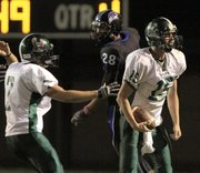 Free State's Kyle McFarland comes down with an interception late in the fourth quarter as Free State played Olathe Northwest in district play Thursday, Oct. 13,2011, at CBAC. Free State defeated Northwest 20-14.