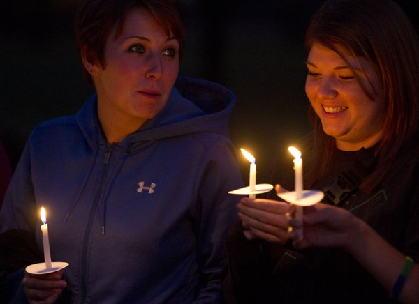 "Jayme Wakefield, Ithaca, Mich., and Mallory Simmens, Jefferson City, Mo., participate in a candlelight vigil during ""Take Back The Night"" on Thursday, Oct 13, 2011, in South Park. The event was held to raise awareness about domestic violence and abuse and to support survivors."