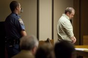 Zachary Harrison waits to be led away Friday by a Douglas County Sheriff's officer after his sentencing in the Nov. 23, 2010, drunken-driving crash that killed Cameron Freeman. Harrison received more than six years in prison.