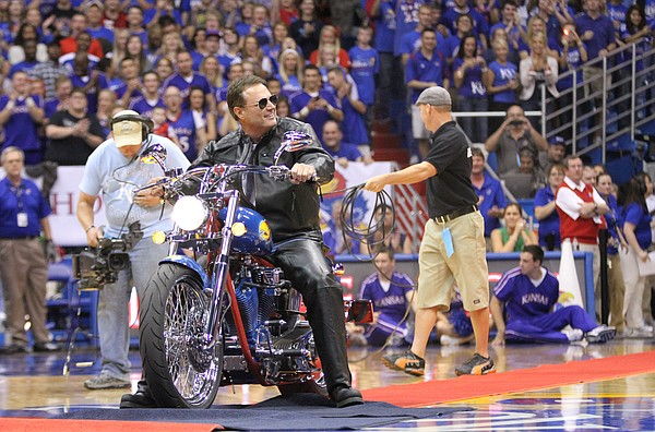 Kansas head coach Bill Self rides out onto James Naismith court on a custom-made motorcycle with imagery from the 2008 National Championship during Late Night in the Phog on Friday, Oct. 14, 2011 at Allen Fieldhouse.