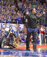 Dressed in leather, Kansas head coach Bill Self gives two thumbs to the Fieldhouse crowd after riding in on a cutom-made motorcycle with imagery from the 2008 National Championship during Late Night in the Phog on Friday, Oct. 14, 2011.