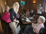 Bertie McConnell, right, celebrated her 90th birthday Saturday with a little surprise added when she was inducted in the Zeta Tau Alpha sorority by Washburn University chapter president Paige Martin, center.