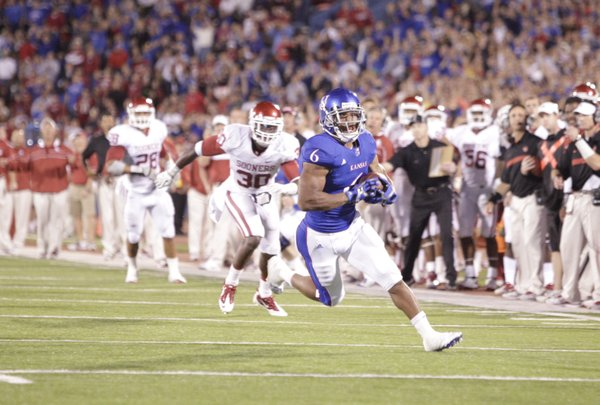 Kansas running back Rell Lewis darts up the field after pulling in a pass from quarterback Jordan Webb against Oklahoma during the second quarter on Saturday, Oct. 15, 2011 at Kivisto Field.