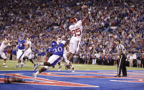 Kansas cornerback Anthony Davis disrupts a pass to Oklahoma receiver Ryan Broyles during a defensive stand in the second quarter that forced the Sooners to settle for a field goal on Saturday, Oct. 15, 2011 at Kivisto Field.